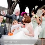 Bartley Lodge Wedding - Sam & Carl getting covered in confetti at the church