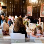 Documentary wedding photograph of guests during the wedding breakfast